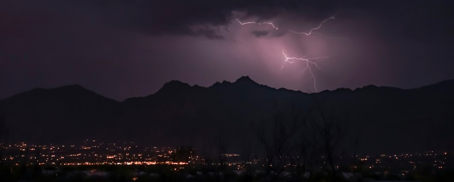 Lightning over mountain silhouettes