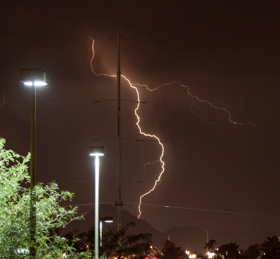 lightning strike looks as if it was pole dancing on a high tension power post