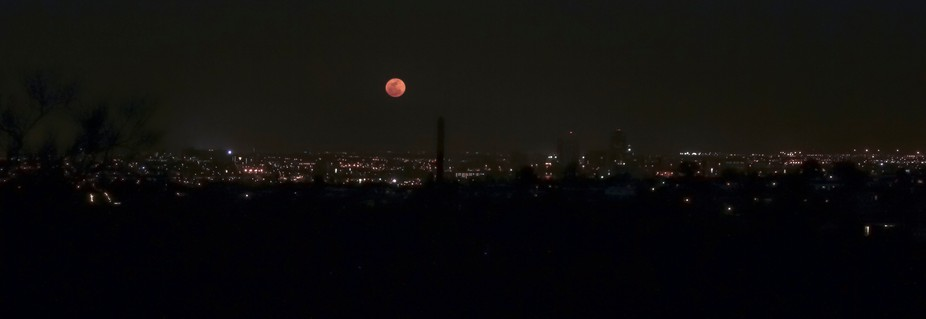 Once a year the LAte September or early October full moon rises over the desert with orange colors and largeness. It is known as the annual harvest moon.