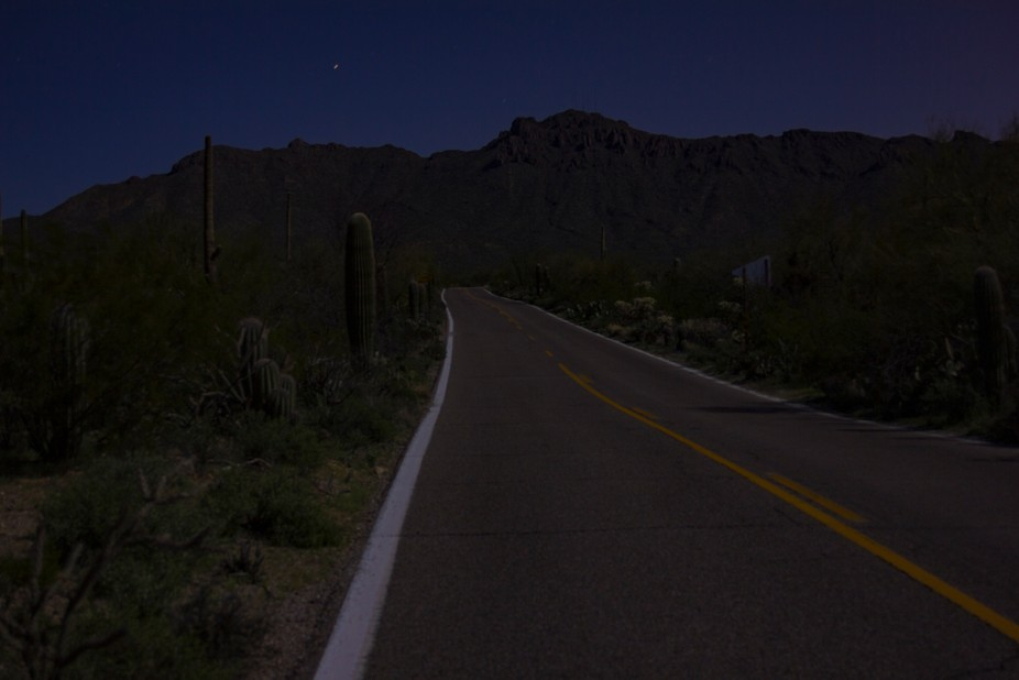 a desert road into the night