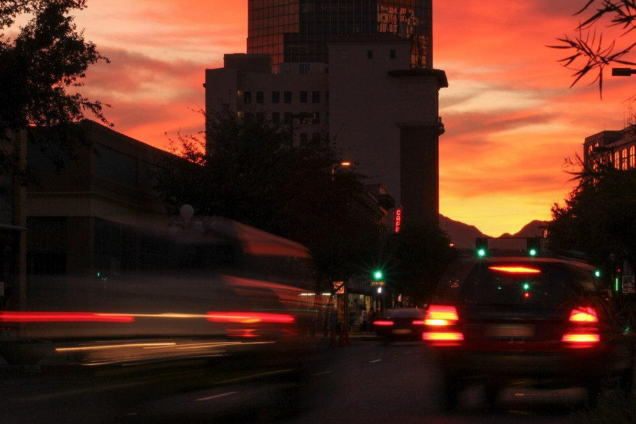 Downtown Tucson at sunset with coincidental signage.