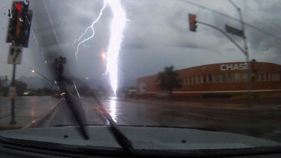 a still frame from a video sequence with an extremely close lighting strike