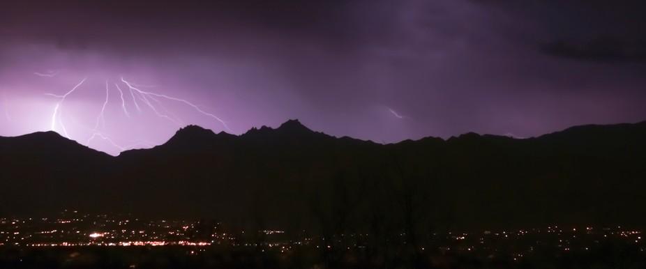 soft streaks of light enhance the mountain silhouette