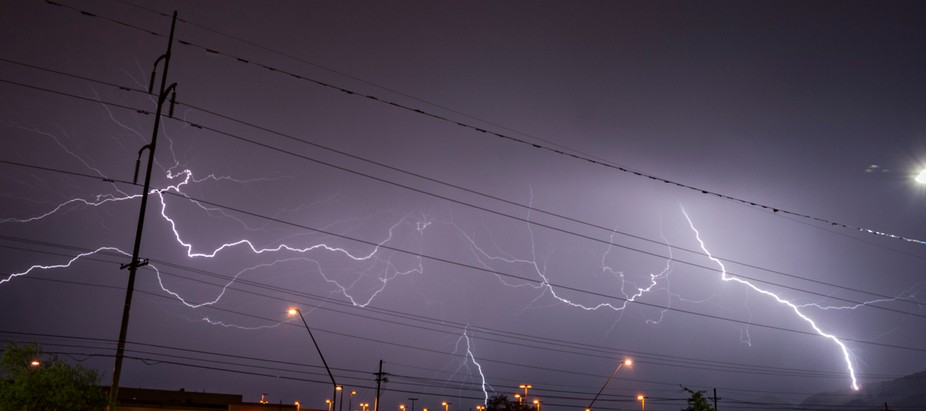 powerlines get a bit lit up by sheet lightning