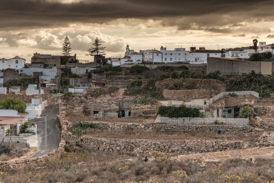 Golden sunset after a thunderstorm over a little village in Tenerife, Canary Islands Spain. You c...