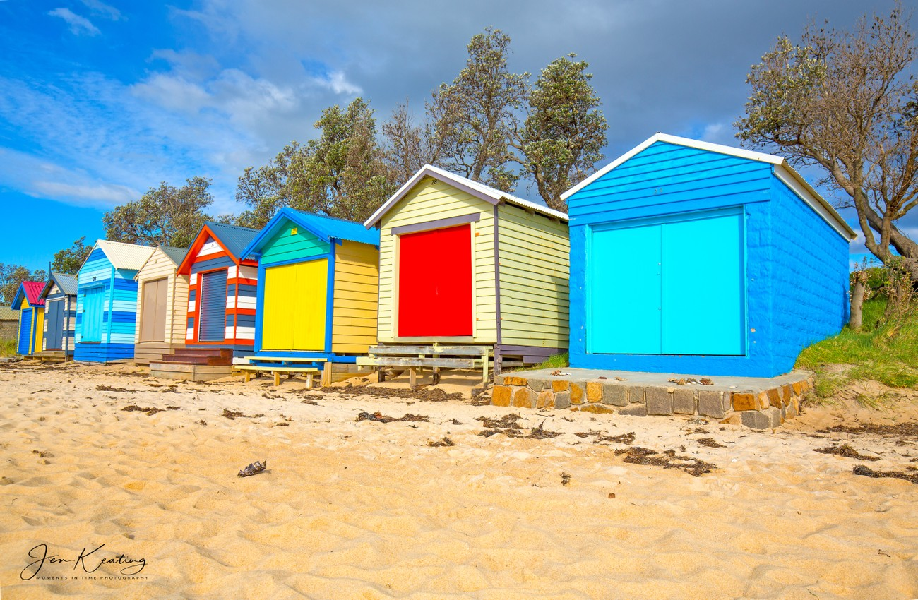 Here in Australia along the coast along Port phillip bay and the Mornington Peninsula and other beach suburbs . you ll see these iconic beach sheds, bathing sheds or some call boat sheds where the owners change into their swimming attire or called bathers, store small boats and beach gear as you can see they are bright and vibrant some are years old but well maintained some are newer with added modifications we love them.