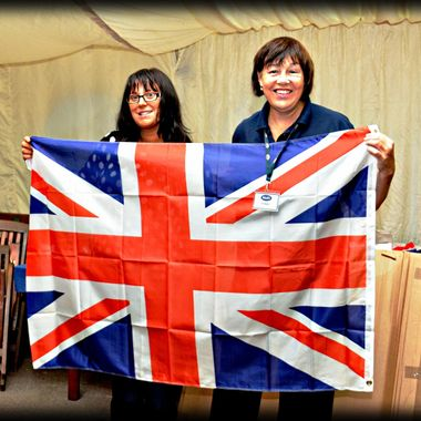 The UJ flag held by Naafi Staff.