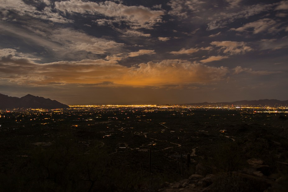 A night view over the city of Tucson towards the end of the monsoon season.