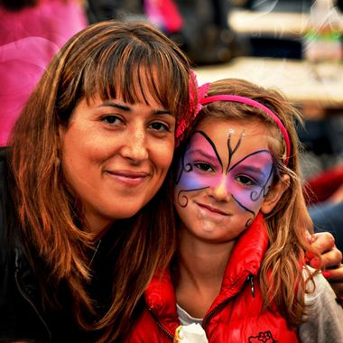 Mum and daughter and face paint.