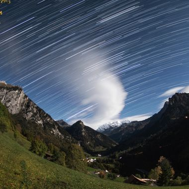 Nightly view from Kiental to Blüemlisalp in the Bernese Oberland, Switzerland during a clear moon-night.