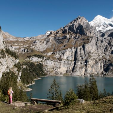 My daughter looking down to the Lake Oeschinen in the Bernese Oberland, Switzerland.