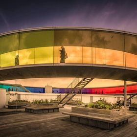 The artwork Your Rainbow Panorama on top of the Aros art museum in Aarhus, Denmark. From the artwork created by Olafur Eliasson you have a colour...