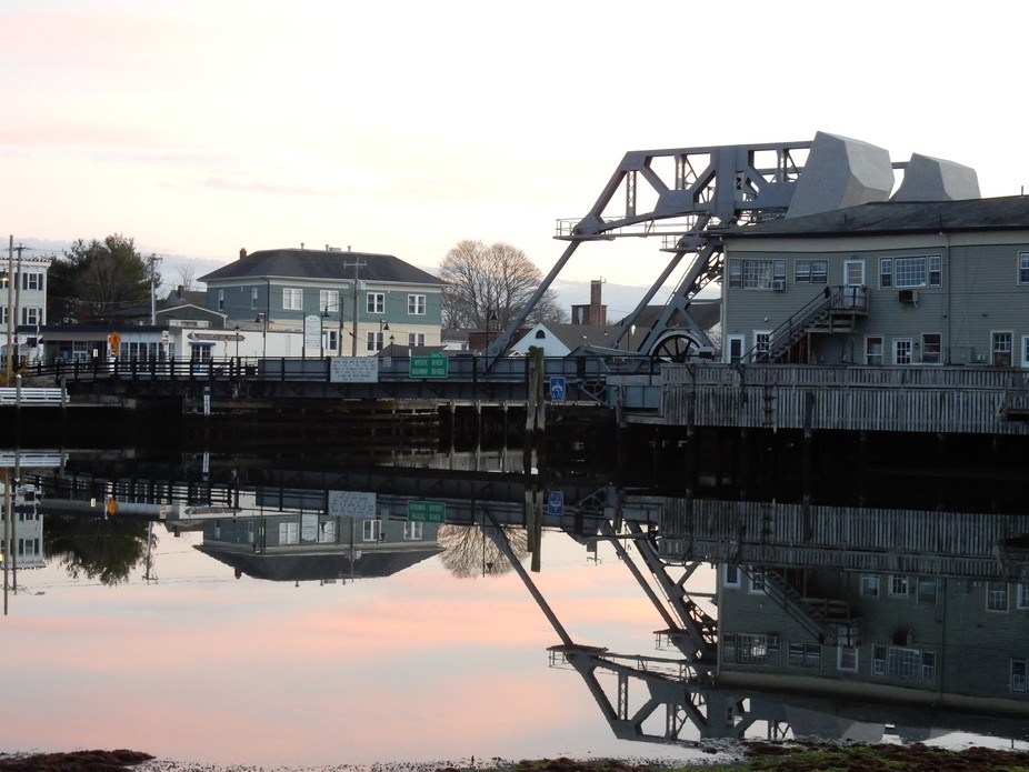 Small town of Mystic CT has a unique drawbridge still in use.  Walking around town to watch the s...