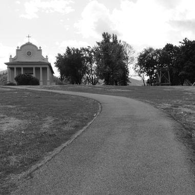 A view of the walkway leading to the entrance of the Sacred Heart Mission (a.k.a. Cataldo Mission) at Old Mission State Park near Coeur d'Alene, Idaho.