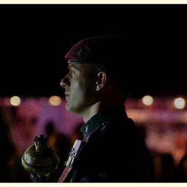 Bandmaster and his mace at night.