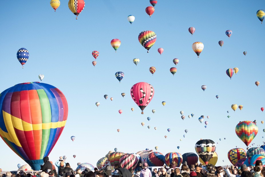 Over 100,000 people in attendance and hundreds of hot air balloons. Make sure you locate the Fiesta buses,location and time they load.   Lens: Nikon 70-300 mms fx