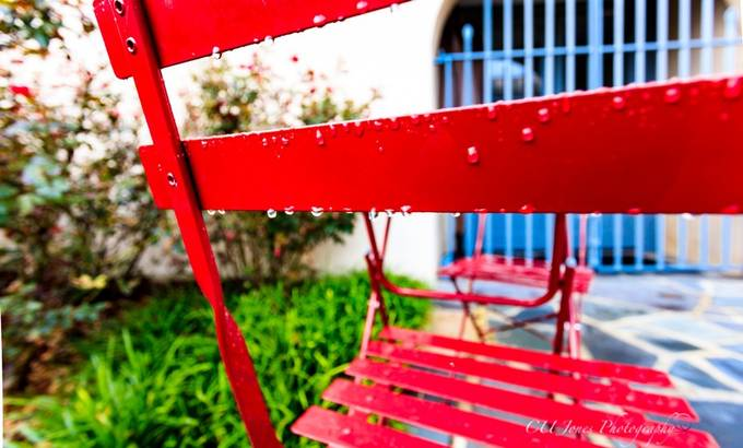 Pretty red chair in a courtyard