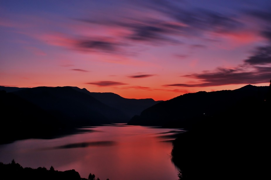 Sunset in mountains lake