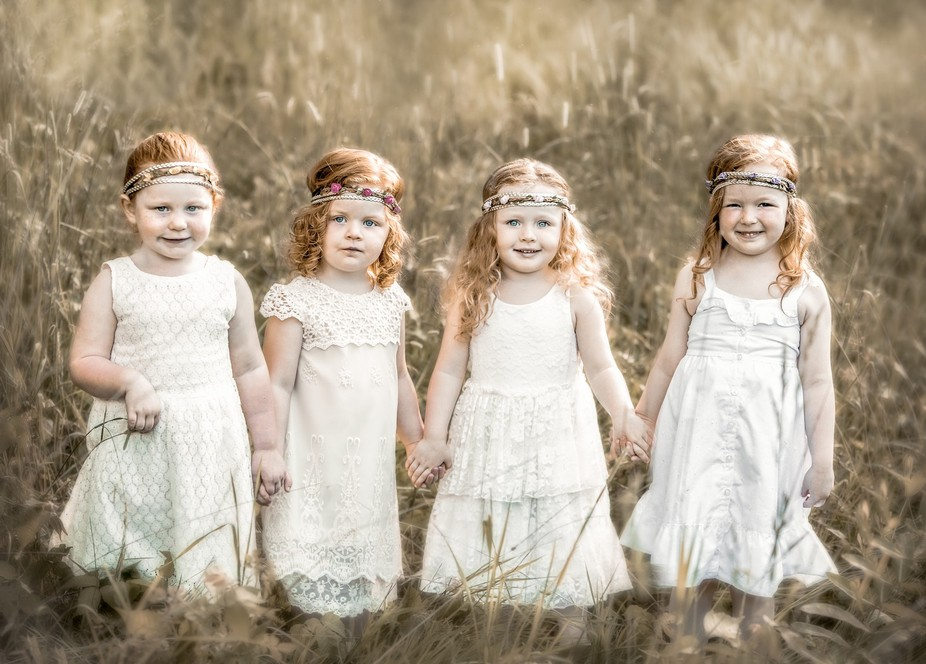 four red headed toddlers in a valley