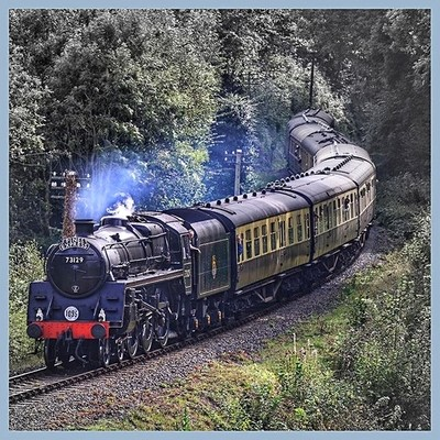 Beautifully preserved STANDARD Class 5, rolls through a leafy canopy on September 21st 2014 at Highley on the Severn Valley Railway.