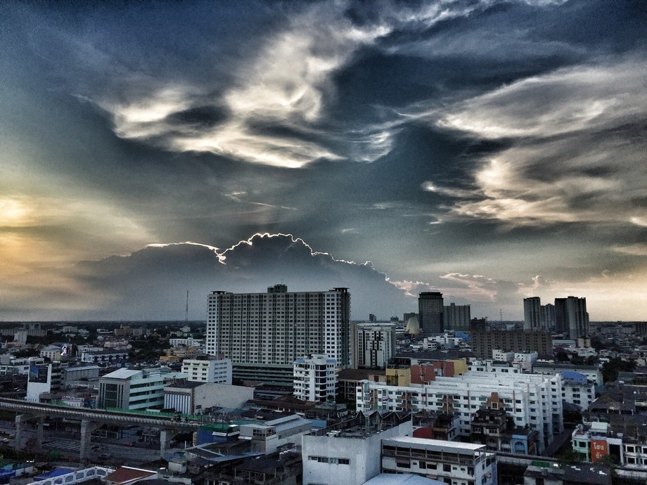 Looking west from our 15th floor apartment in Bangkok. The white line around the cloud behind the...
