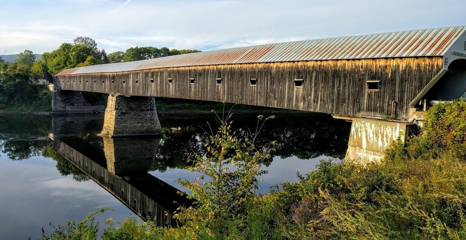The world's longest covered bridge connects Vermont & New Hampshire over the Con...