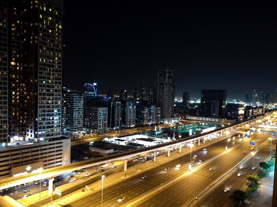 I enjoy watching fast cars in Dubai .. full of life .. hence captured this from my hotel balcony