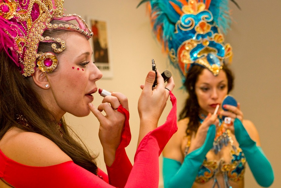 The Brazilian Carnaval is full of colors, music and costumes.  These two women are dancers for a ...