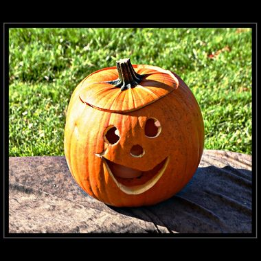 A smiling carved Pumpkin.