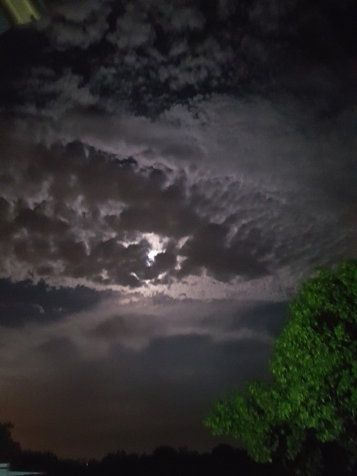 Full moon on a cloudy night produced nice contrasts.
