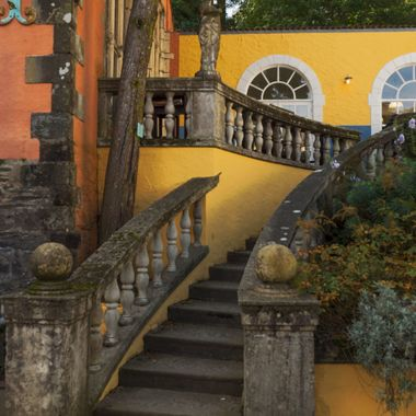 A curved staircase to a café terrace to the right of the Town Hall at Portmeirion.