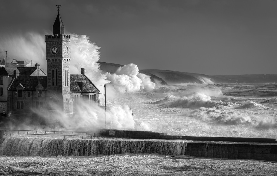 Giant swells hit Cornwall, UK.   I watch on in amazement as giant waves batter Porthleven, fighti...