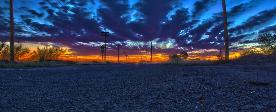 HDR image of an infinite road at sunset