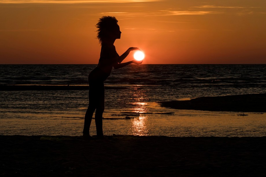 Trying to take the sun on the beach of Fregene close to Rome Italy