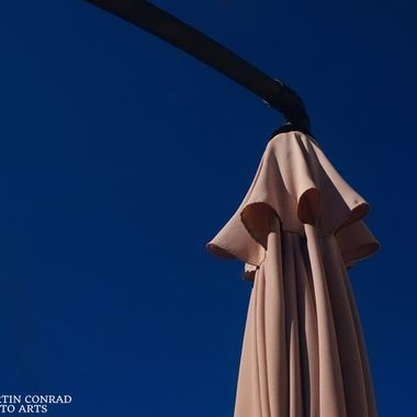 A Table Umbrella Folded For the Winter Season