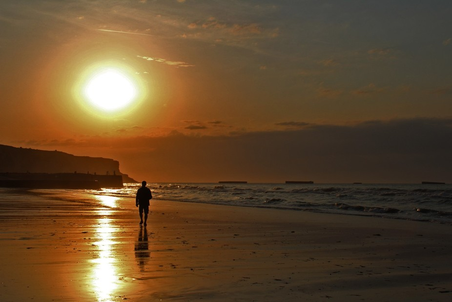This photo was taken on the coast of Normandy. I was walking with my dad on the beach and i tough...