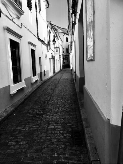 Narrow street in old Jewish Quarter in Cordoba Spain