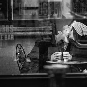 Couple kissing while having a coffee. Pic taken in Temple Bar area, Dublin.