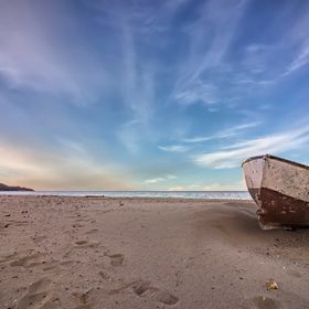 lonely old boat on the beach