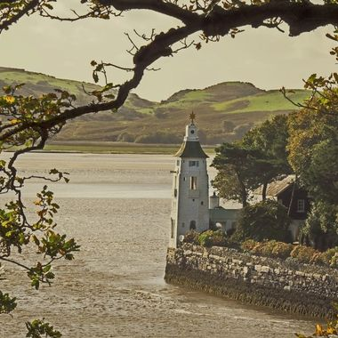 This looks down from the proximity of the Portmeirion entrance area showing the end of the Promenade and the River Dwyryd with the tide in.