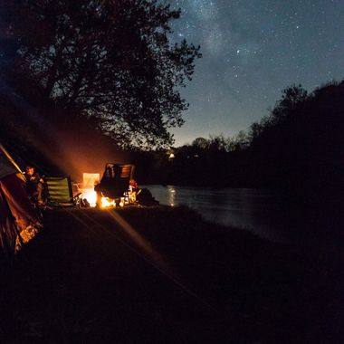 Storytime around the campfire under the Milky Way.