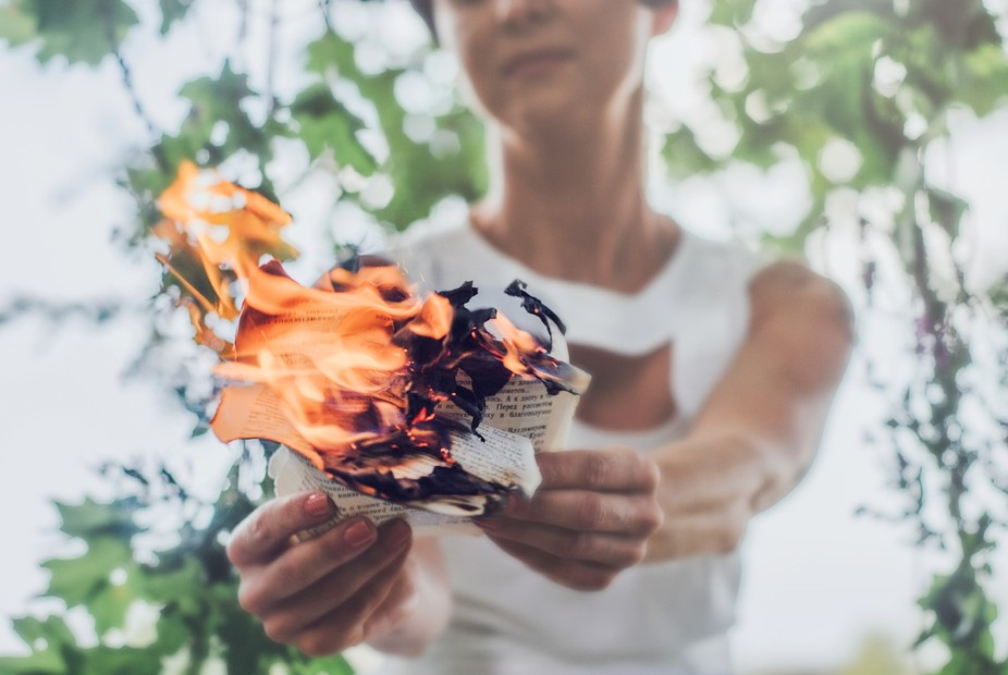 Woman says goodbye to past memories and burning her diary
