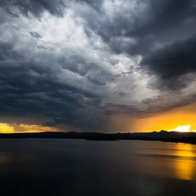 Passing storm over the North Pine Dam, Queensland Australia at sunset