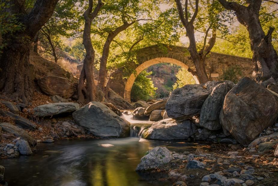 arched stone bridge near Karystos.