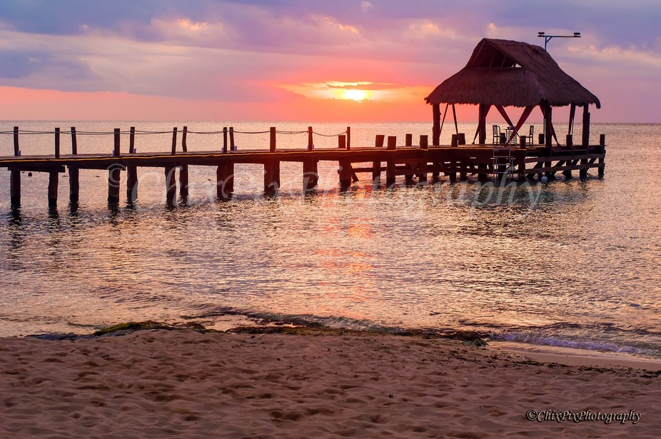 A pier in Mexico set up for dinner for two at sunset.  2012-11-24 MX 649 WWM
