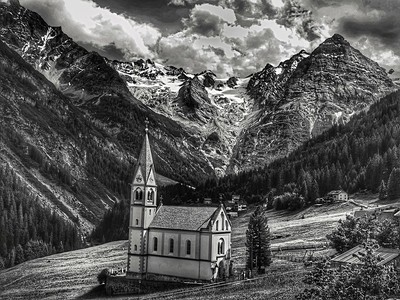 Standing tall, small church in the Dolomites
