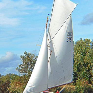 Yacht under Sail on the River Ant.