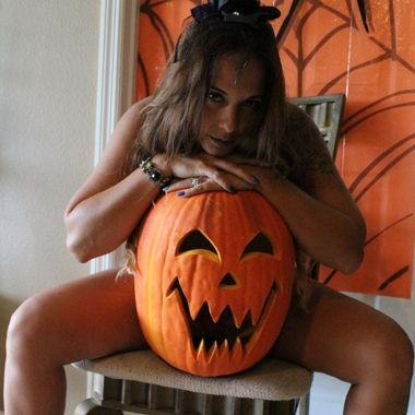 My model having nothing to hide for Halloween, Because she's wearing nothing, but a really spooky jack-o-lantern & dare you to come closer & say trick or treat.