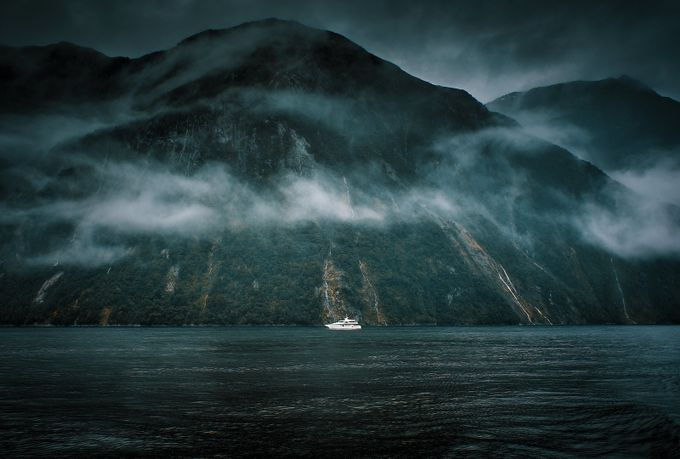 Boat In Mist At Milford Sound, NZ. by tassietom - Moody Vistas Photo Contest