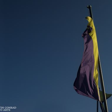 Flag fluttering against a clear blue sky